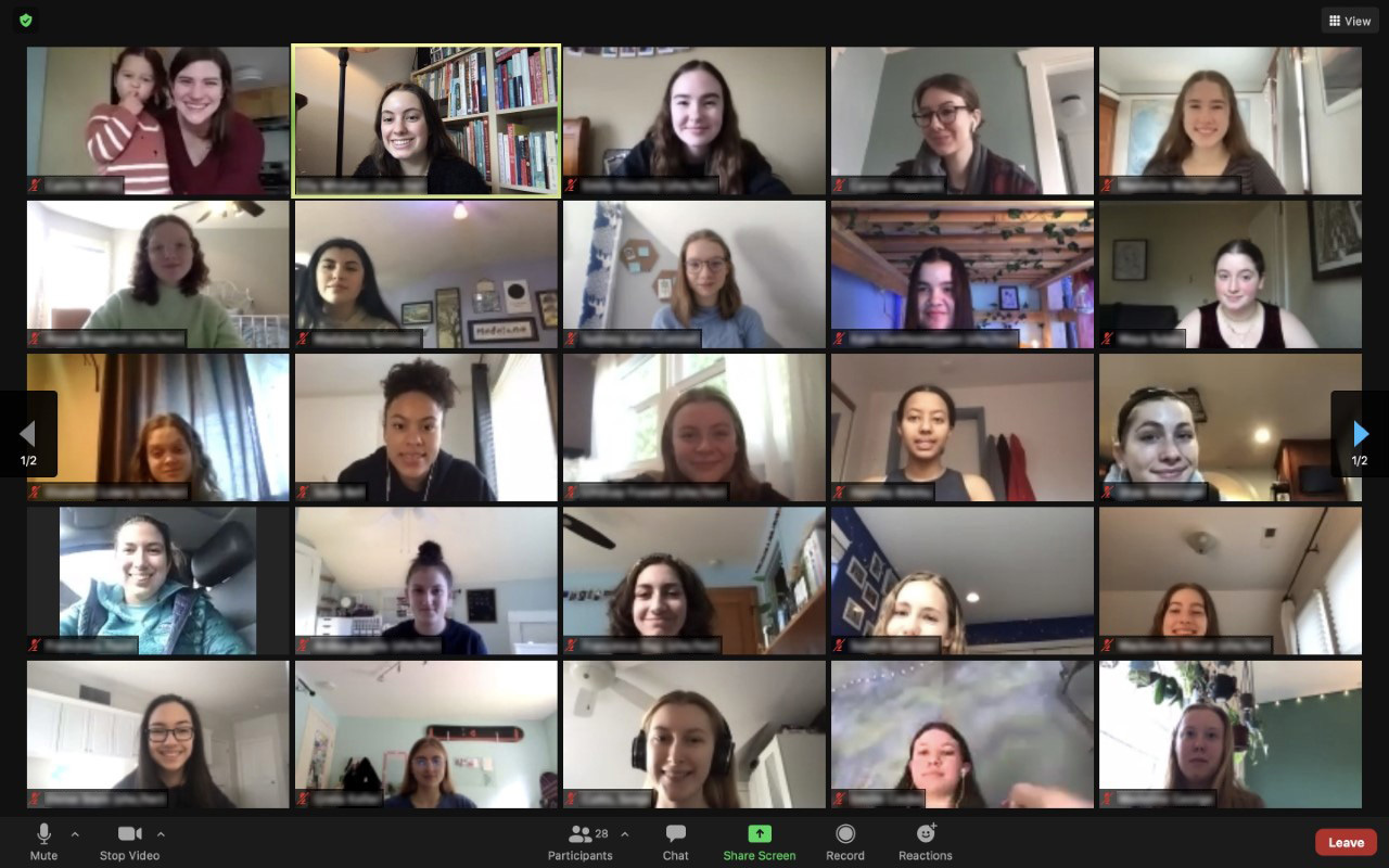 Zoom screenshot of 25 CommuniCare participants smiling into the camera.